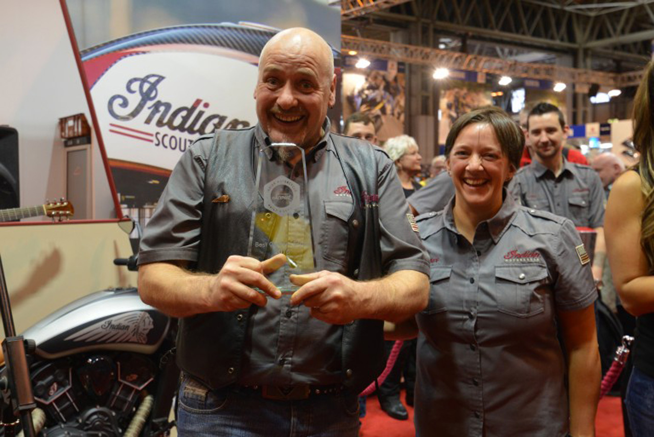 Sarah Johnson, marketing specialist for Indian Motorcycle in the UK, presents Thor Motorcycles dealer principal Colin Treleaven with a trophy for winning Project Scout UK